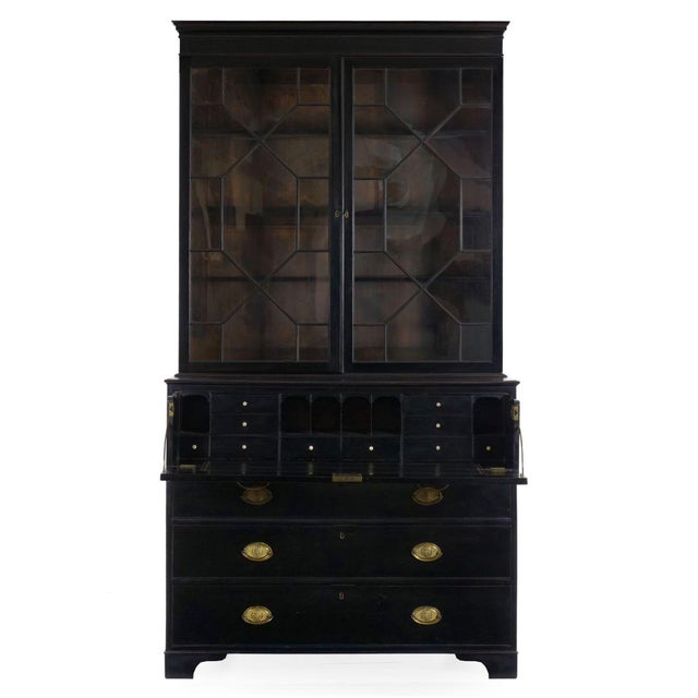 "A finely crafted secretaire situated as a bookcase over a chest of drawers, the upper drawer is ""Butler"" in form,..."