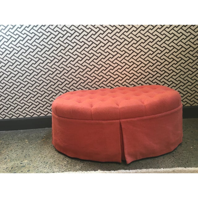 Custom made tufted and skirted oval ottoman in slubby coral/salmon pink linen. Fabric: Pierre Frey Collotweed Framboise