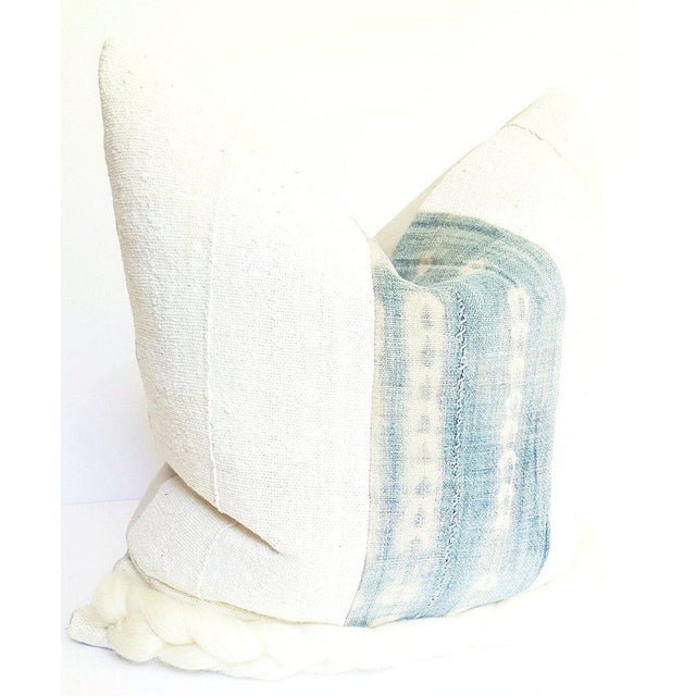 Hand crafted throw pillowcase featuring a vintage, natural white, African mud cloth textile paired with a faded blue with...