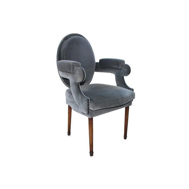 This velvet stunner would make for a fantastic office chair or vanity perch. The chair has a few blemishes to the fabric,...