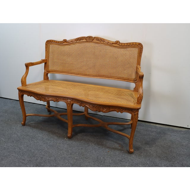Louis XV Style Walnut and Caned Settee, acanthus leaf decoration at crest, double cross stretcher, caned back and seat,...