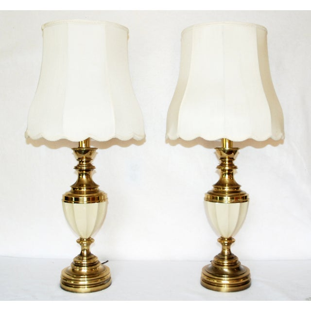 A pair of heavy brass and porcelain Stiffel lamps. Both lamps are in very good condition . Both lamps have the original...