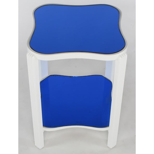 Restored gloss white lacquer over maple Art Deco end table with original blue mirrored top. Squared bow tie shaped two...