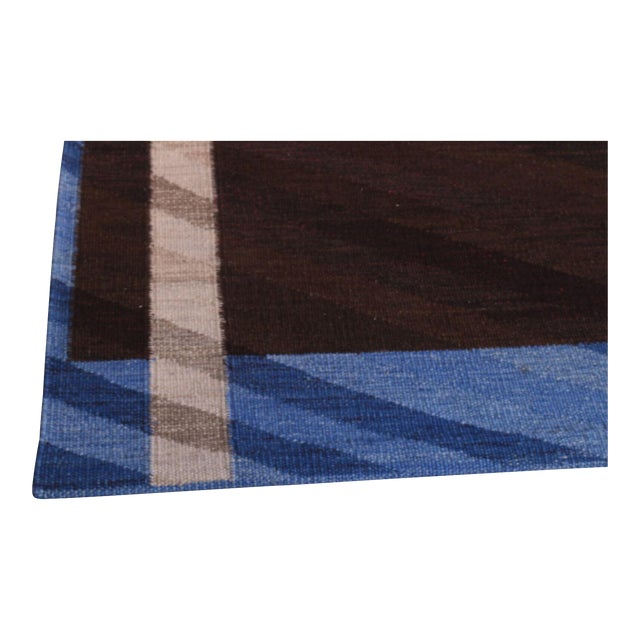 Well designed piece, this flatweave has bold handsome colors fitting as a centerpiece to any living room.