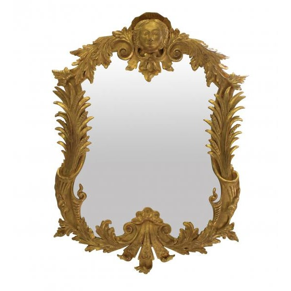 A pair of large carved and water gilded George III style Classically inspired mirrors.
