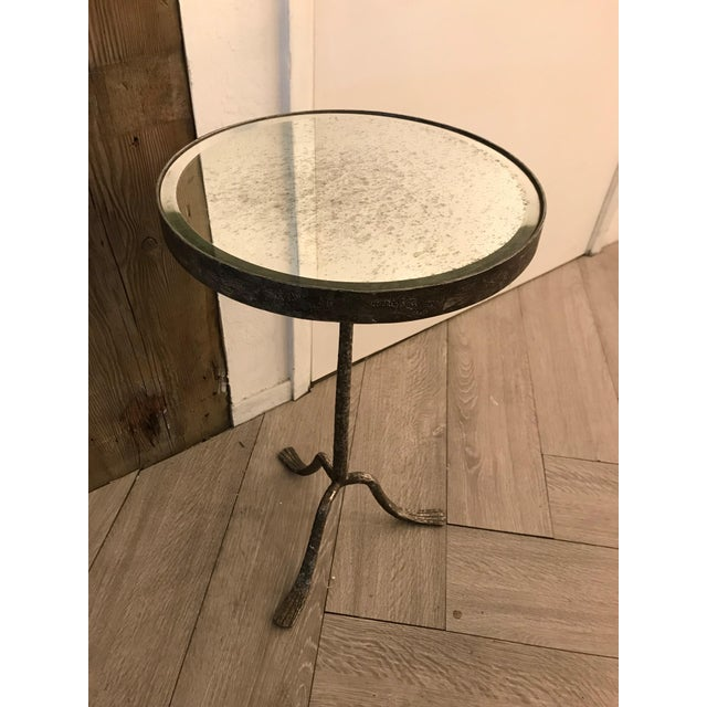 Charming grey side table with unique metal feet. Perfect addition aside a bed or between two comfy reading chairs.