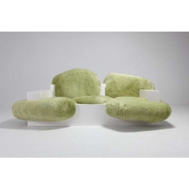 Pillow couch (prototype) in white lacquer and green faux fur, developed at alfa.brussels. Schimmel & Schweikle is an...