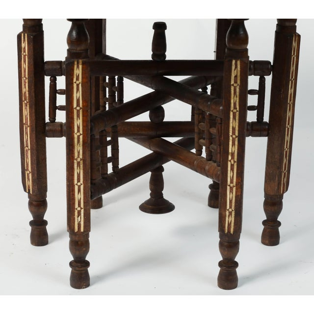 Middle Eastern Syrian antique brass tray table with wooden stand. Handcrafted brass top is decorated with Arabic...