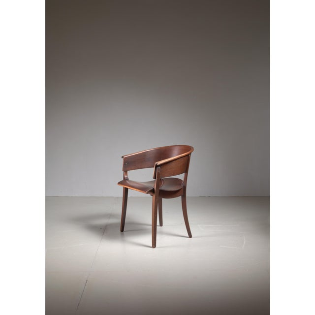 A curved armchair designed around 1928 by Ernst Rockhausen for Rockhausen, Germany. The chair is made of beech plywood and...