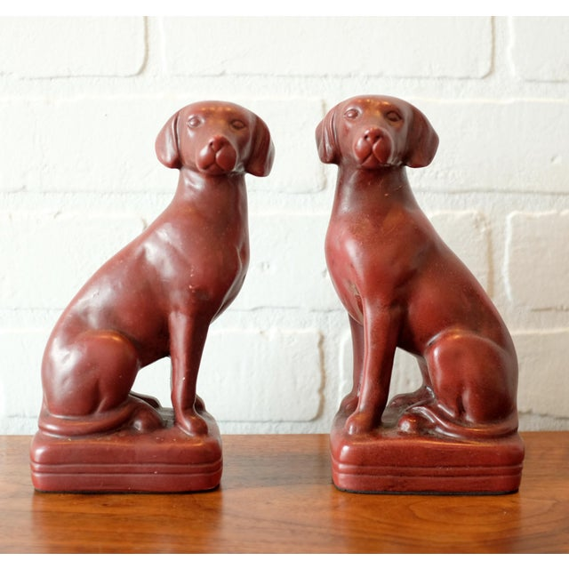 A pair very sturdy vintage dog bookends in a rich deep red. They are unmarked, maker unknown.