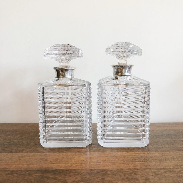 The crystal decanters were made by the iconic London jeweler Asprey and feature sterling silver hardware. Dimensions...