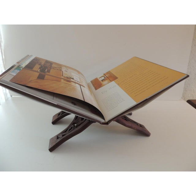 "Folding Indian hand carved book display or stand. Size: 13""W x 8""H x 7.5""D"