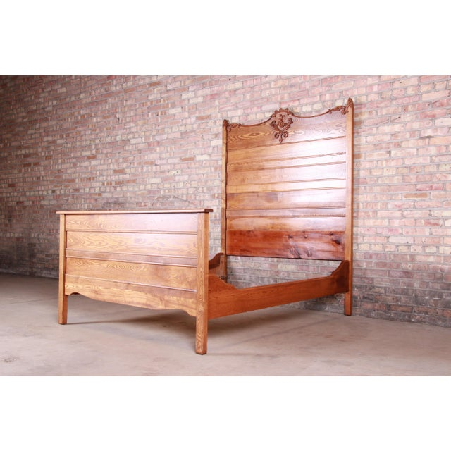 """A gorgeous antique carved oak full size bed frame USA, Circa 1900 Measures: 58.13""""W x 76""""D. Headboard 73.13""""H; footboard..."""