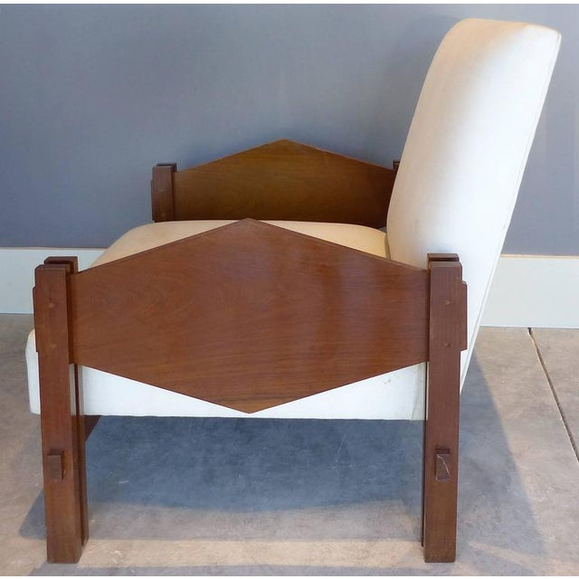 "A wonderful organic pair of Jacaranda wood ""geometric"" armchairs by Brazilian master cabinet maker and designer Jose..."