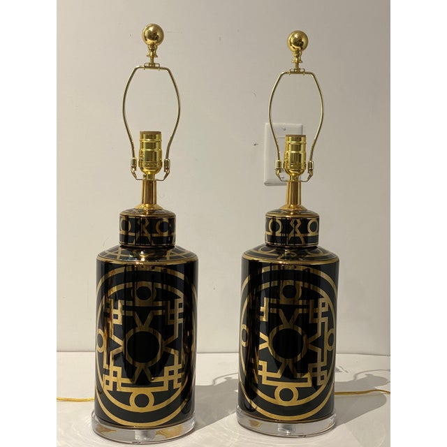 Chic pair of black ceramic porcelain and Lucite table lamps, Mid-Century Modern with abstract gold design. Each measures 6...
