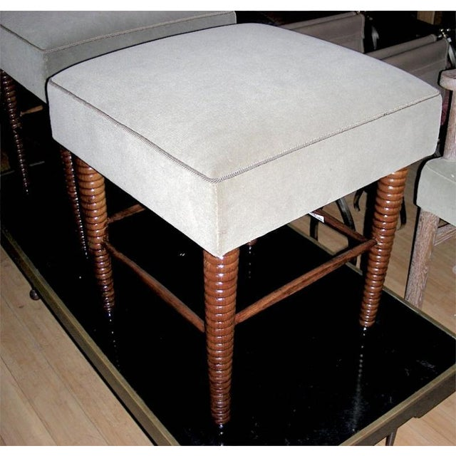 Chic pair of stools with exquisite legs by Maison Jansen.
