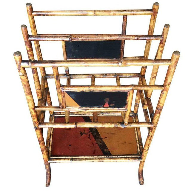 Large two-tier antique tiger bamboo magazine rack with divider and bottom self for larger books. Decorative hand -painted...