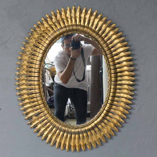 Pair of Spanish, 1940s gilt metal mirror was sun rays. The metal has a rich gold patina.