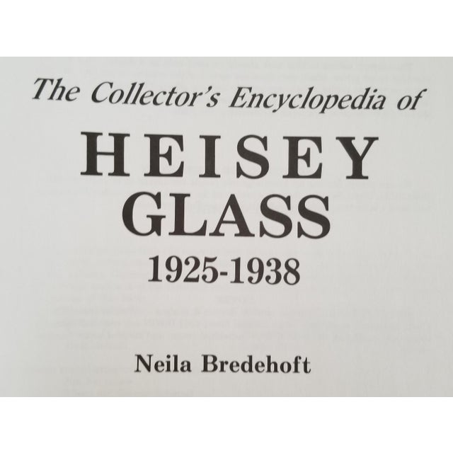 The Encyclopedia of Heisey Glass 1925-1938 by Neila Bredehoft. Hardcover, illustrated, 463 pages. Great coffee table book!!