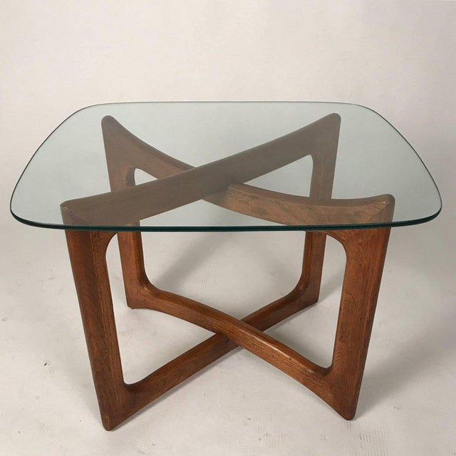 Gorgeous Mid-Century Modern sculptural walnut base with glass top pair of tables. Designed by Adrian Pearsall for Craft...