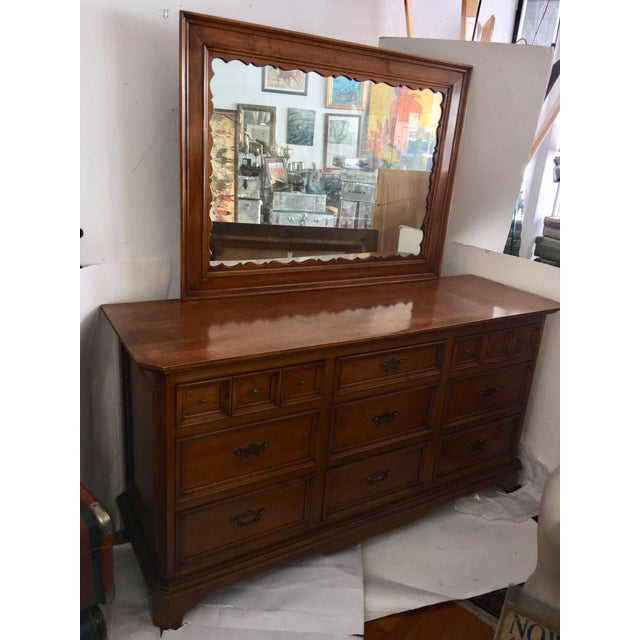 A beautiful used wood chest of drawers with a wonderful mirror top. Elegant design and a warm wood tone. In very good...