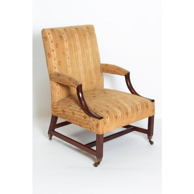 """An 18th Century George III """"Gainsborough"""" library chair of plain substantial construction standing on square legs with an..."""