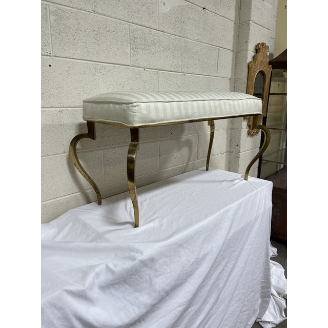 This is a stunning Italian brass bench. So well constructed. Brass and metal frame by which the upholstered cushion rests...