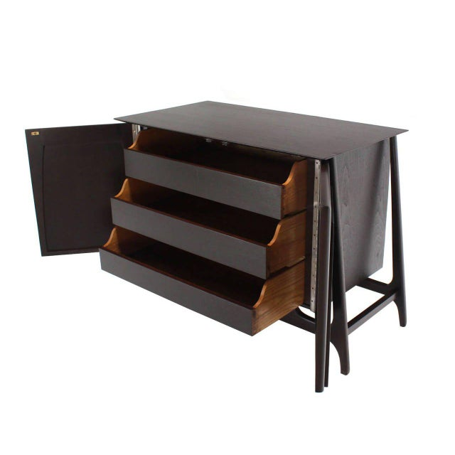Mid-Century Modern two-door three drawers sculptural server or bachelor chest.