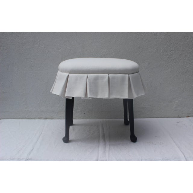 Fabulous oval stool with box pleated skirt upholstered in Perennials outdoor fabric. Ebonized wooden legs.