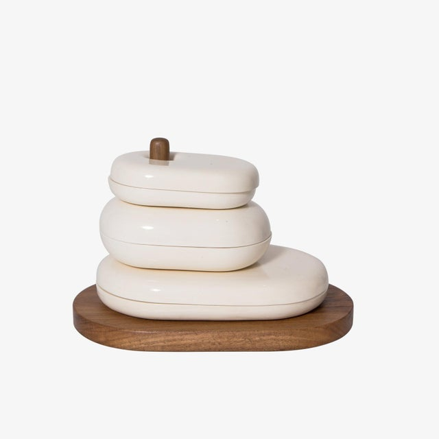 Gloss ceramic dish set on hand turned wood stand by El Salvadorian industrial designer, Maria Jose Nuñez. Maria's focus is...