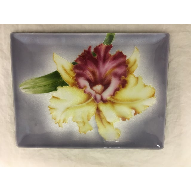 A beautiful lavender enameled orchid tray by Tutanka with orchid. Circa 1960s, this vintage piece is in flawless...