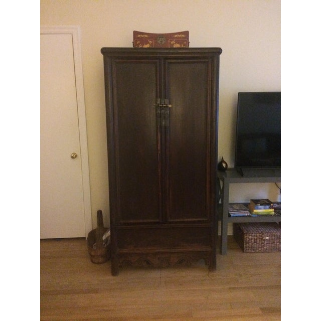Beautiful antique Chinese armoire bought in Beijing. It is very old (1800's) but in good condition with original hardware...