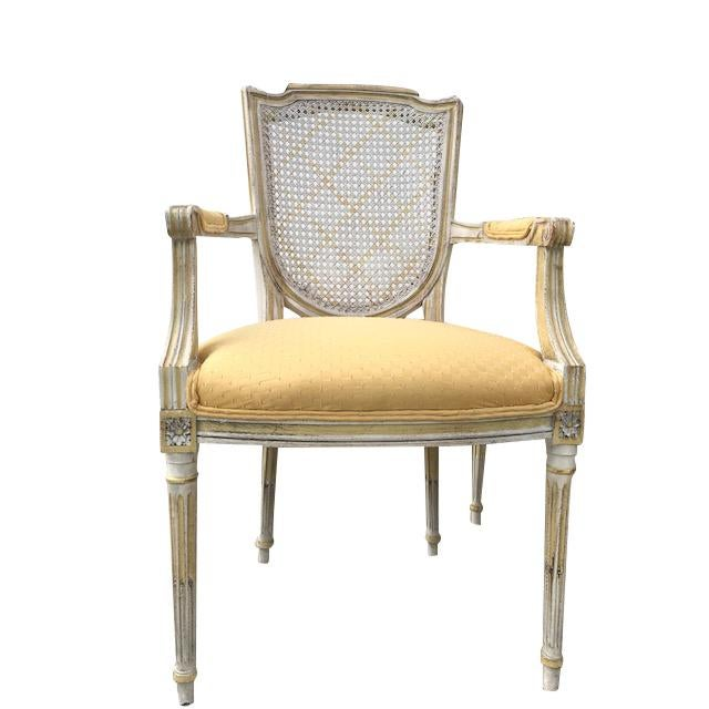 Fabulous set of vintage european style Louis XVI painted dining chairs that includes 6 armless and 2 arm chairs. The paint...