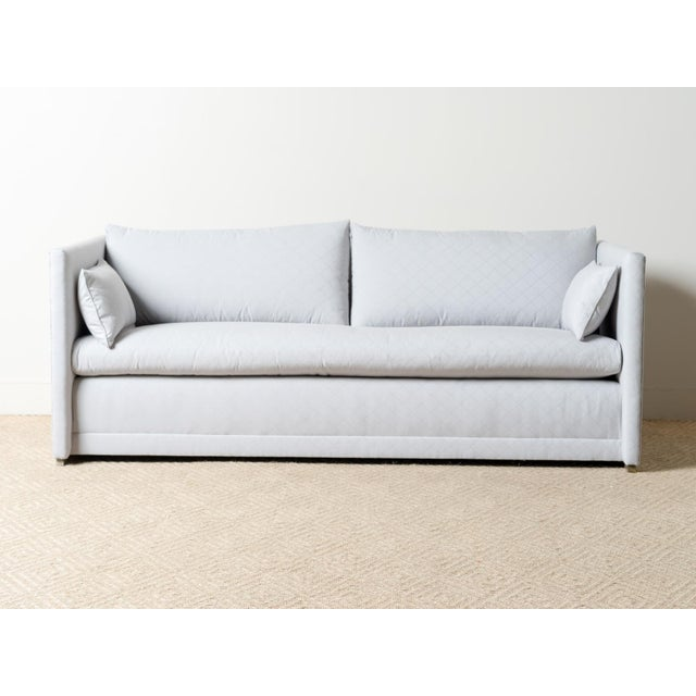 Tight upholstered sofa Fabric: Perennials Outdoor luxury, 100% solution-dyed acrylic Two blendown arm pillows Light Oak base