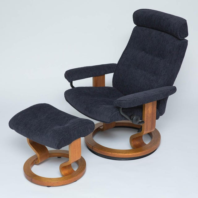 """Newly reupholstered in a navy blue Hinson fabric. Chair reclines and swivels. 16.5""""sh"""