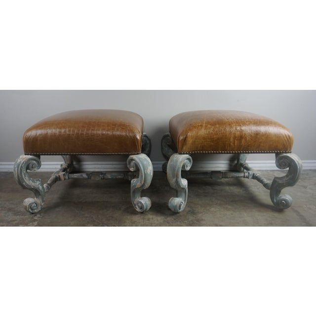 Pair of Louis XV style painted French benches standing on four cabriole legs with worn gray painted finish. The four legs...