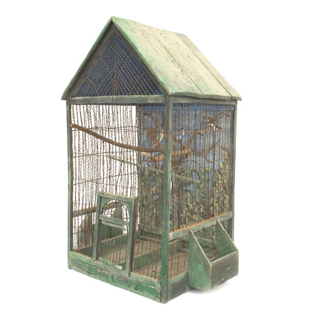 Rustic English Country Victorian green painted and wire bird cage with a peeked roof and a troupe l'oeil back panel with a...