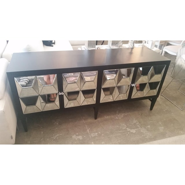 This is a beautiful mirrored sideboard that will be perfect for your living room. The angled mirrors on the doors really...