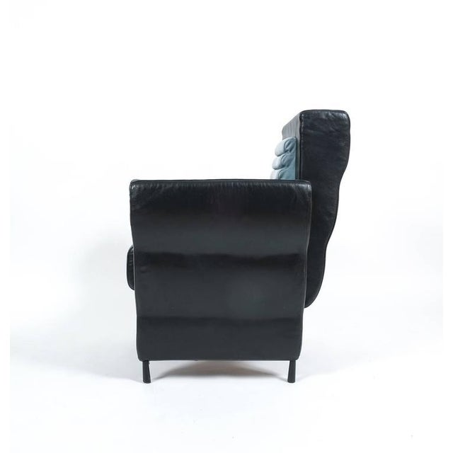 Rare leather armchair from the Flessuosa series by Ugo La Pietra for Busnelli, Italy, 1985. Comfortable smooth leather...