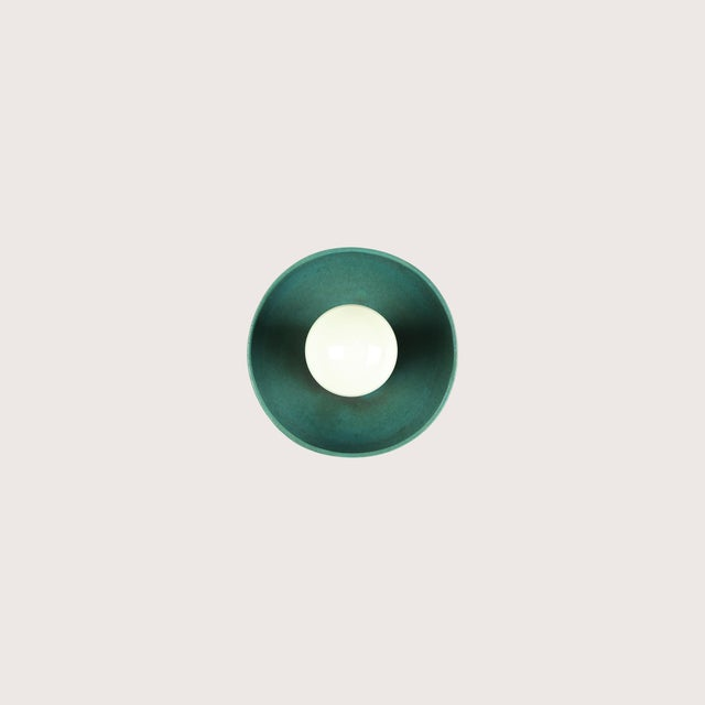 The Emmet wall sconce was created as a simple, elegant form to showcase the beauty of glazed terracotta. UL Listed. Made...