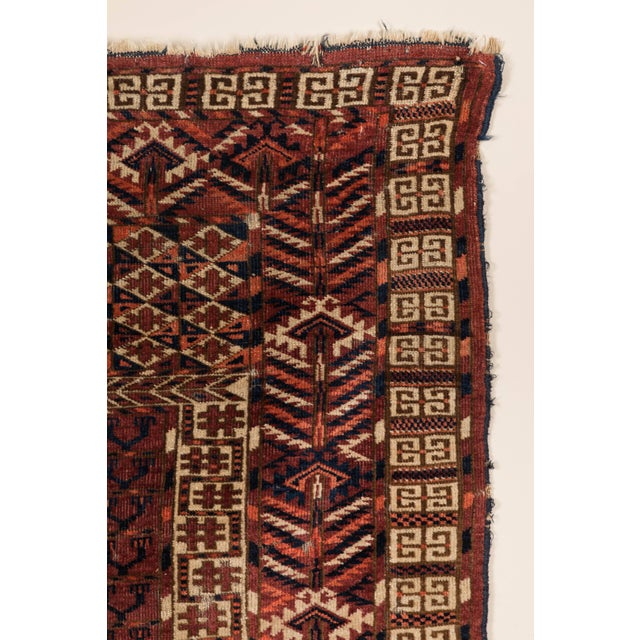 Early 20th century hand-knotted, wool pile tribal rug. Low pile. Few minor repairs and minor damage at end. Offered by .