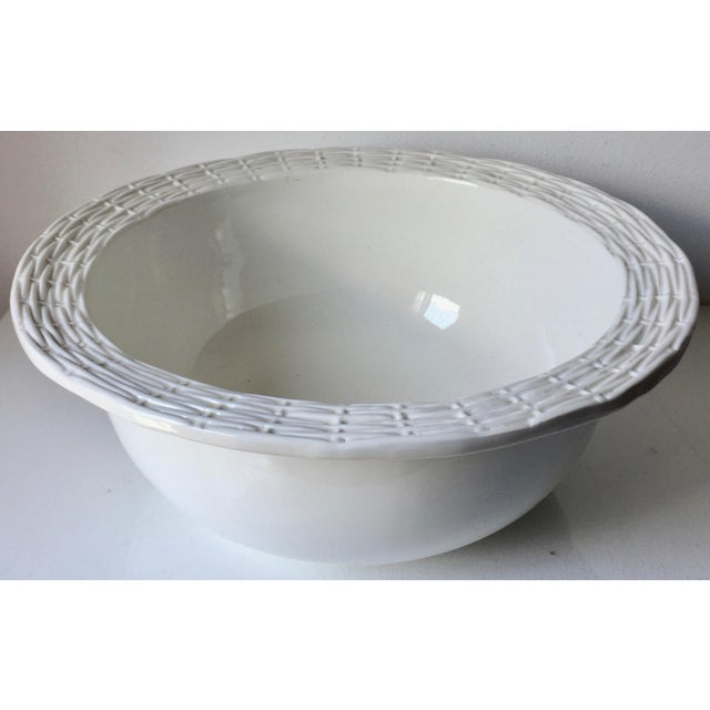 This wonderful large Italian ceramic serving or salad bowl was made for Neuwirth. Classic basket weave design, works well...