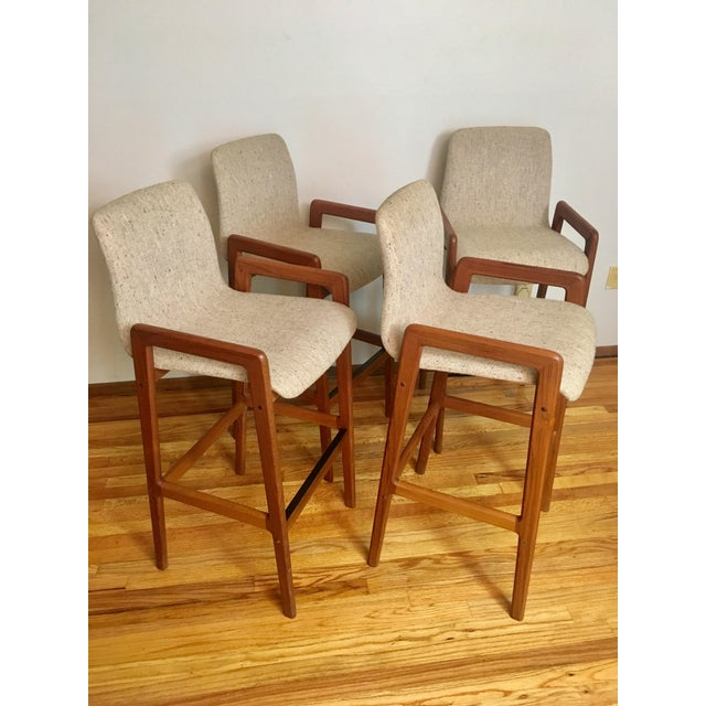 Extremely sumptuous to the touch; soft teak wood; knubby wool upholstery in oatmeal. They appear as if untouched; all...