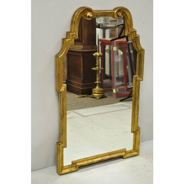 Italian Gold Giltwood Hollywood Regency Scroll Wall Console Mirror by Kent Coffey. Item features the original Italian...