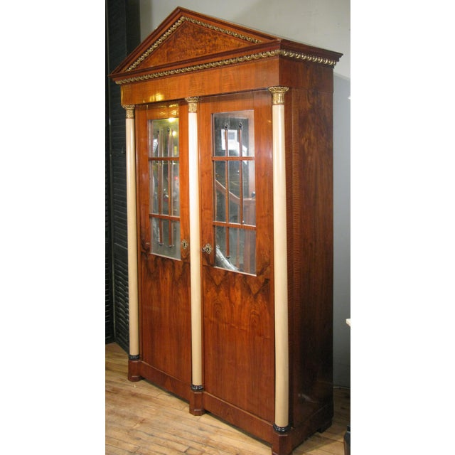 A gorgeous antique 19th century Biedermeier cabinet with a recent beautifully fitted cabinet interior with drawers and...