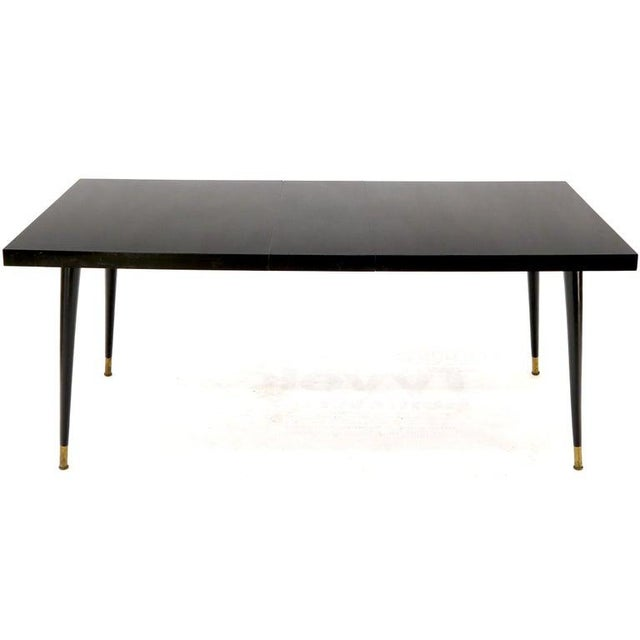 Mid-Century Modern Black Laminate Tapered Dowel Legs Dining Table With Extension Board For Sale - Image 3 of 11