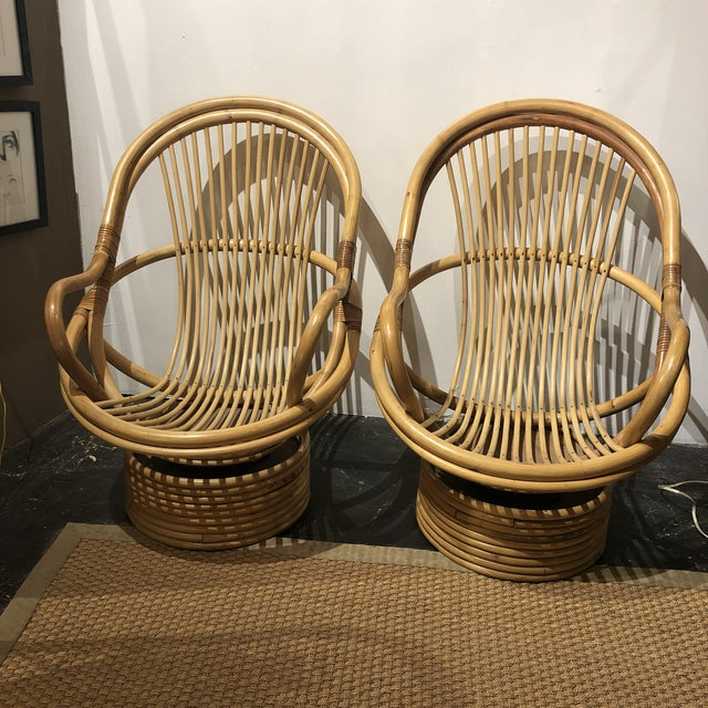 A pair of vintage bamboo swivel chairs . Sturdy stylish and comfortable.Throw a sheepskin on there and they look BOHO chic!