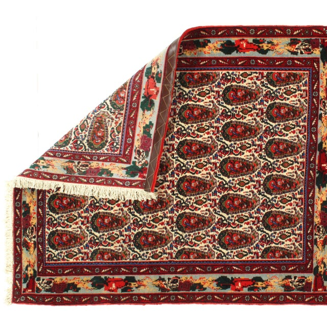 This is a Persian sene lamb's wool and cotton rug. Vegetable Dyed. This rug has a dense, soft pile, and excellent quality,...