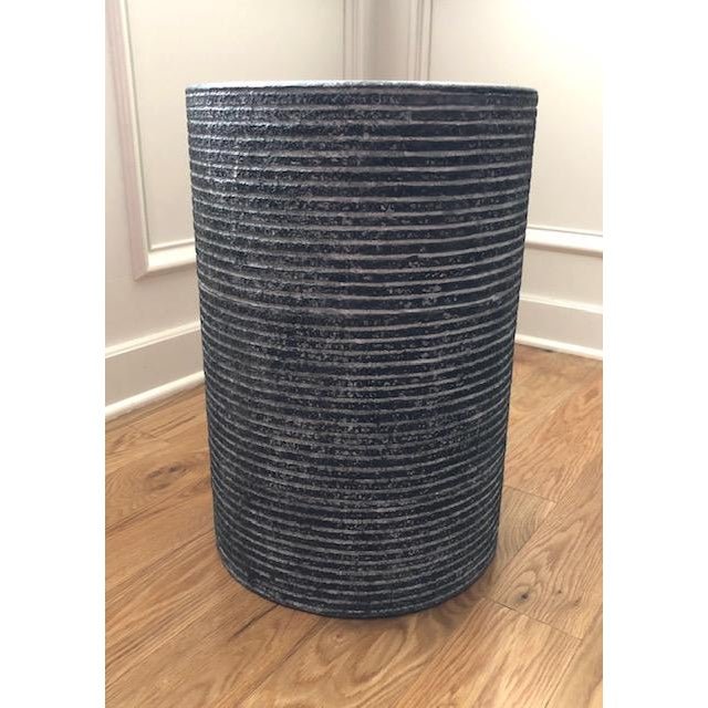 """""""Cerused"""" textured cast stone accent table measuring 13"""" in diameter and 20"""" high. Suitable for use indoors or out."""