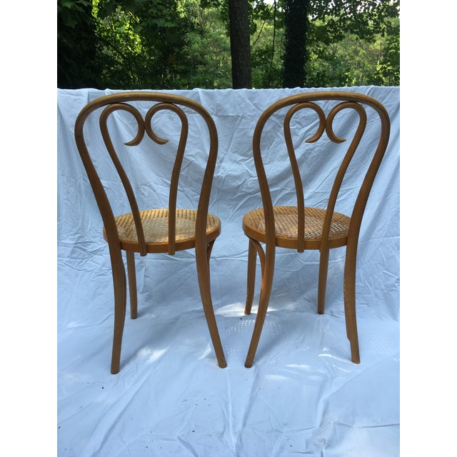 Great pair of made in Romania mid-mod cane seat sweetheart bistro thonet stlyle chairs. Perfect to tuck in for extra...